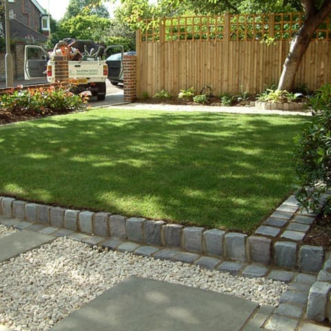 Driveway and raised cobbles with area laid to lawn in Putney