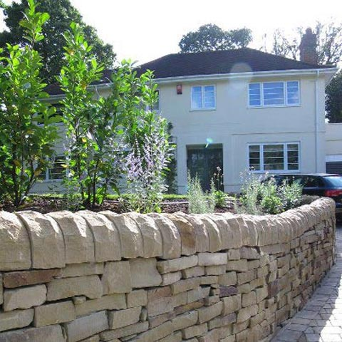 Beautiful York stone dry wall with bedding and block paved driveway in Esher