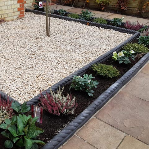 Buff Indian Sandstone paving with Victorian rope edging in Kingston-upon-Thames