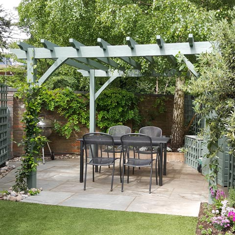 Large Pergola and Grey Indian Sandstone paving in family garden in Surbiton