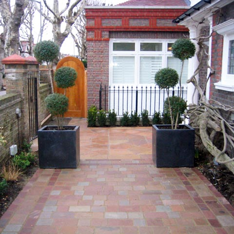 Sawn Sandstone with powder coated iron railings and intricate paving in Putney