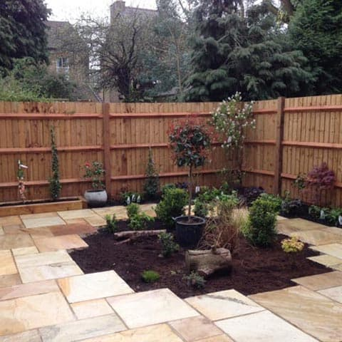 Sandstone paving with central planted area in Twickenham