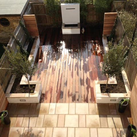 Hardwood decking project with stone planters in Thames Ditton