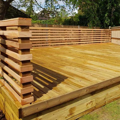 Cedar batten Venetian style fence with softwood decking in Surbiton