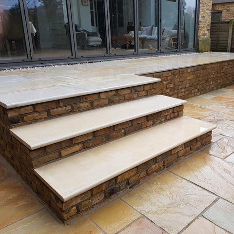 Fossil Mint Indian Sandstone patio and retaining wall in reclaimed London Stocks in Kingston-upon-Thames