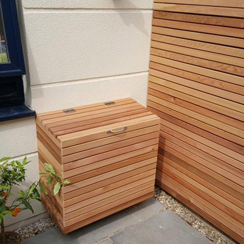 Raised rendered seating area with bespoke storage in Cedar in Teddington