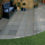Cobble edged grey sandstone paving in Esher