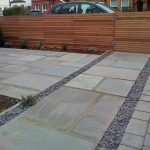 Handsome Grey Sandstone drive and path with Cedar trellis in New Malden