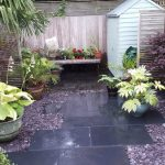 Black Limestone paving with coloured gravel in Surbiton