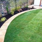 Curved paved edge to lawn area in Thames Ditton