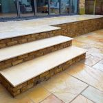 Fossil Mint Indian Sandstone patio and retaining wall in Twickenham