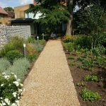 Gravel path with border planting and lighting in Richmond-upon-Thames