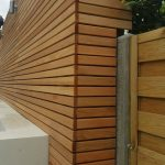 Raised rendered seating area and fences in Cedar in Teddington